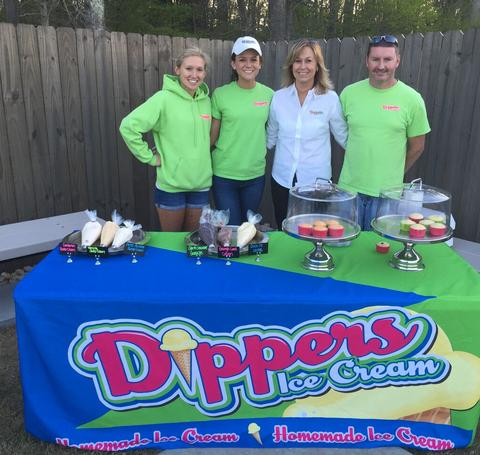 The Dippers Staff Standing Behind a Dessert Table